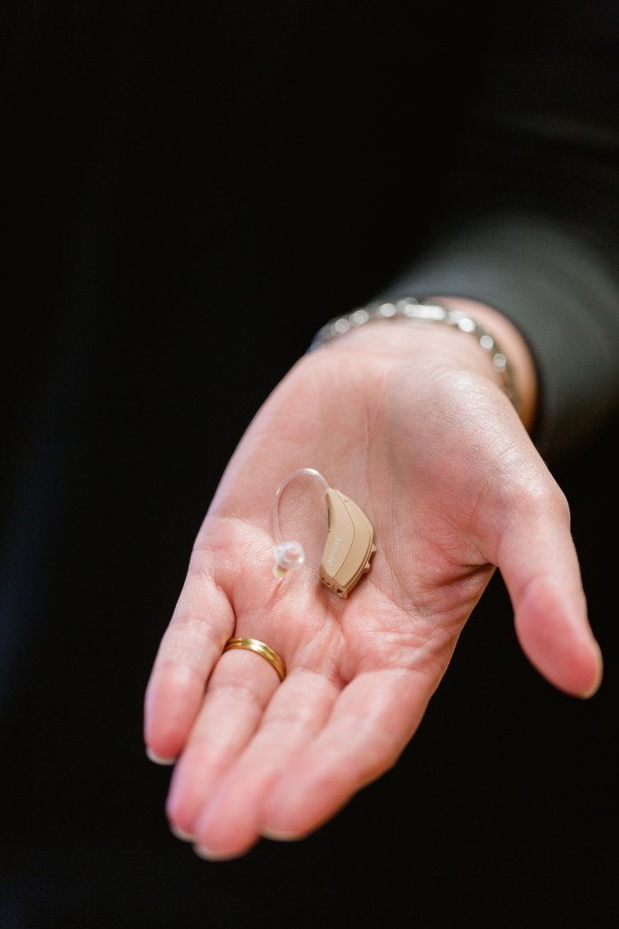 hearing aid in a woman's hand